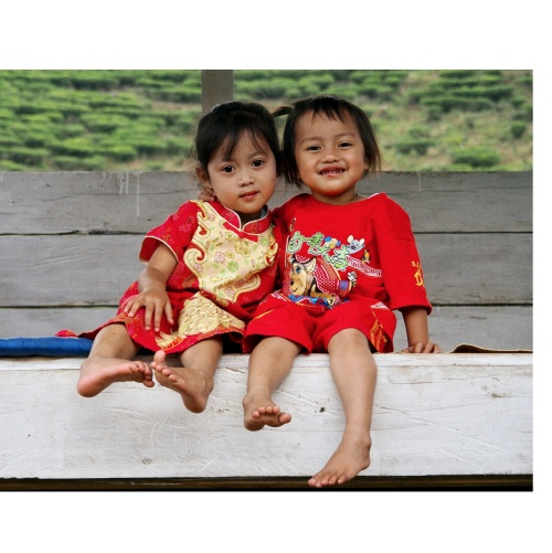 memories from Indonesia : these two beauties were playing under the shadow of a hut in a tea plantation, while their mom was taking a rest from work.